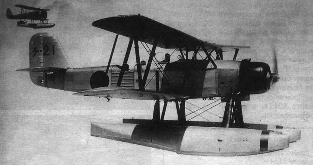 Kawanishi E7K2 three-seat floatplane with Nakajima E8N in background